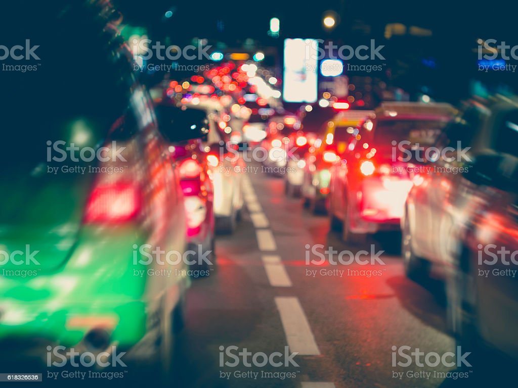 Traffic jam Cars driving slow lights Highway Road rush hour stock photo