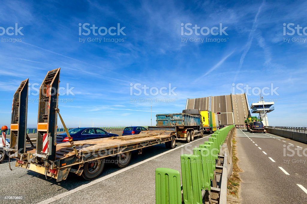 Traffic jam on a highway for an open bridge stock photo