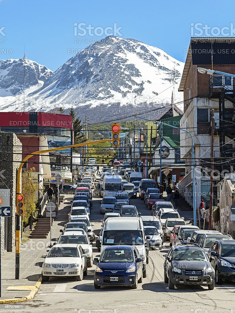 Traffic jam on street with mountains. stock photo