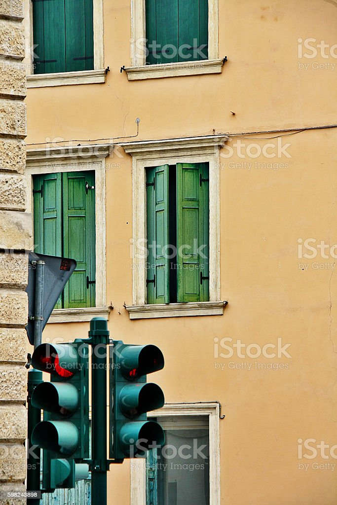 Traffic light and color building in background, Verona, Veneto, Italy stock photo