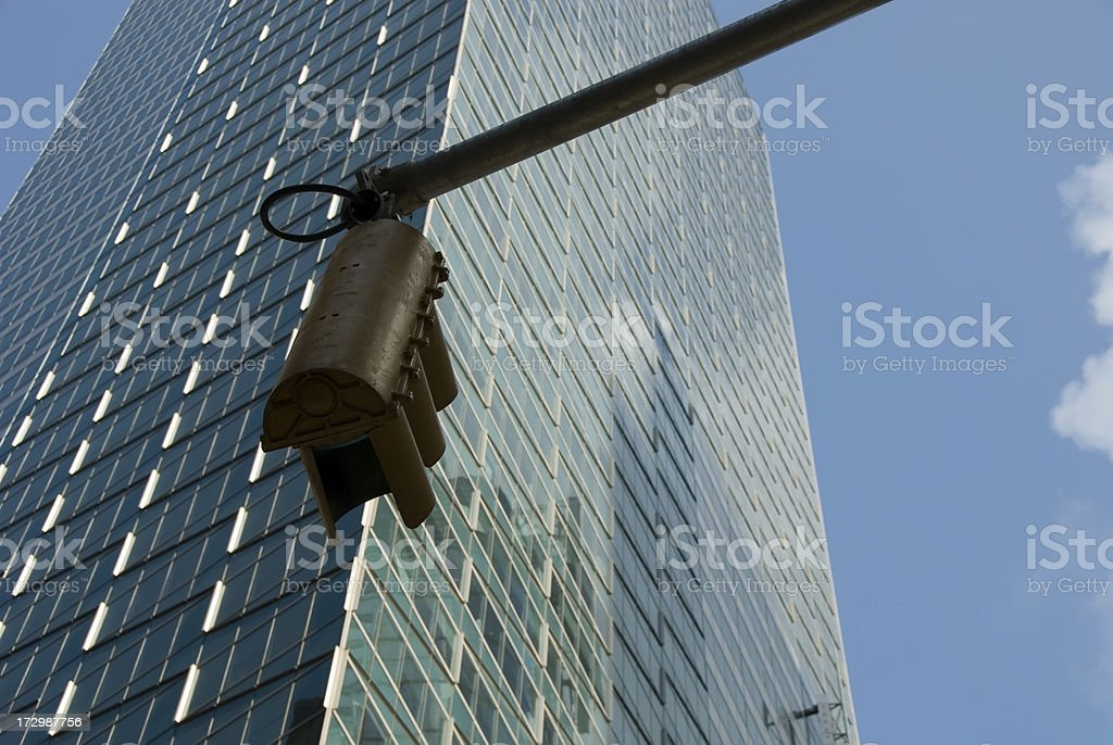 Traffic light and skyscraper royalty-free stock photo