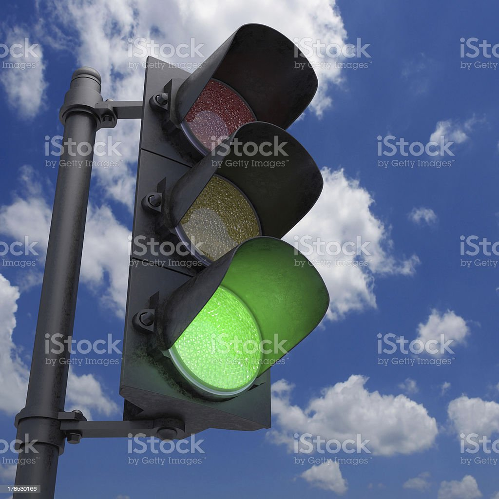 A traffic light is signaling green stock photo