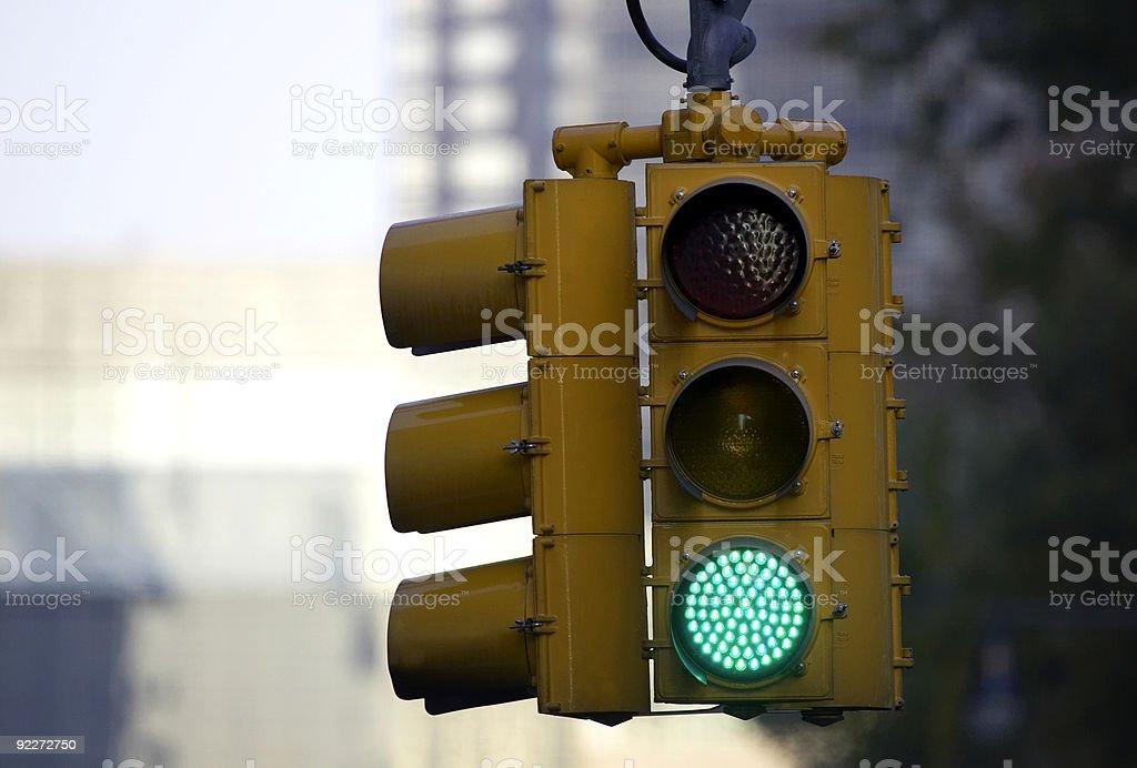 Traffic light on green stock photo