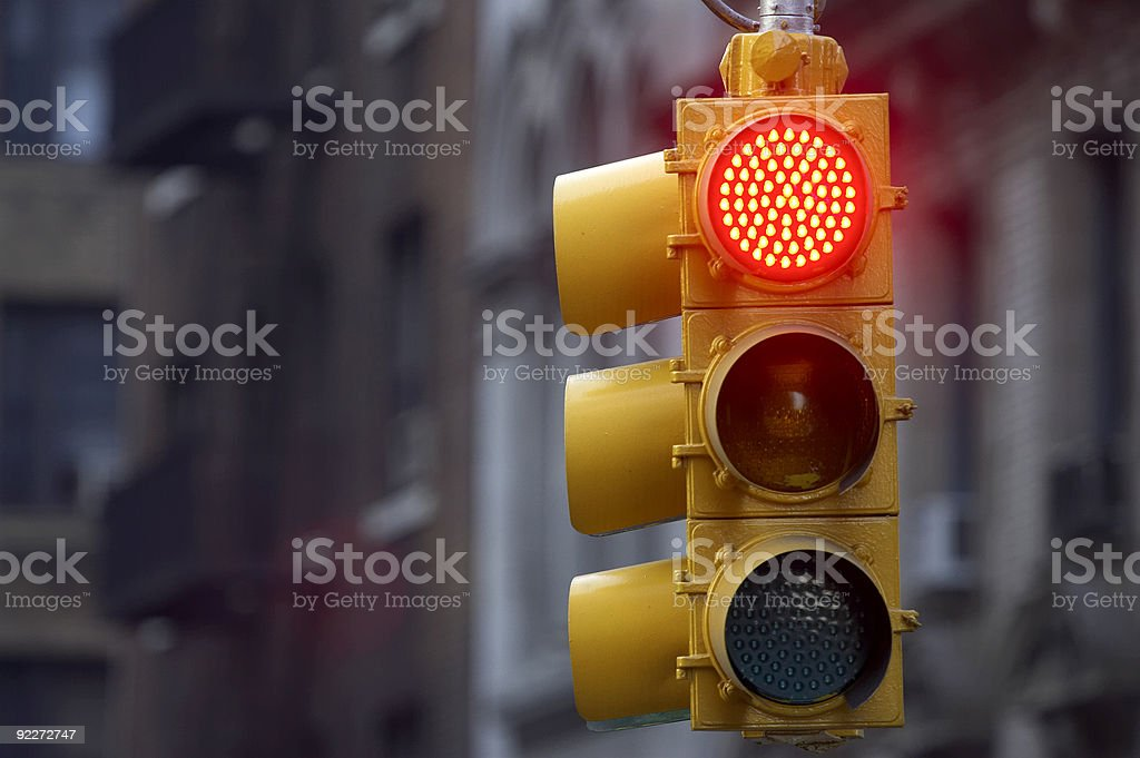 Traffic light on street with red signal lit up stock photo