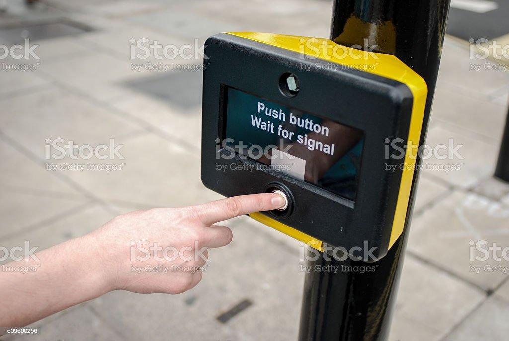 Traffic light pedestrian crossing button stock photo