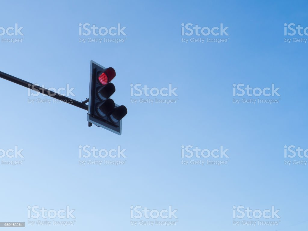 Traffic light red with blue sky background stock photo