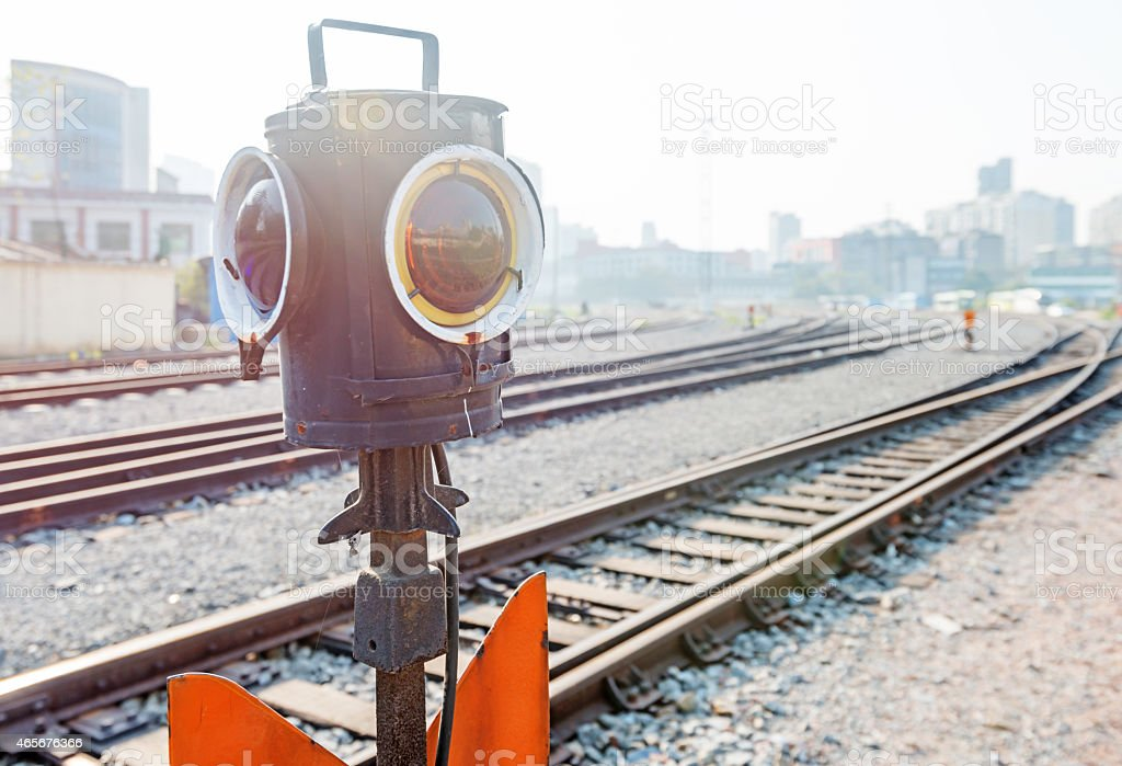 Traffic light shows blue signal on railway stock photo