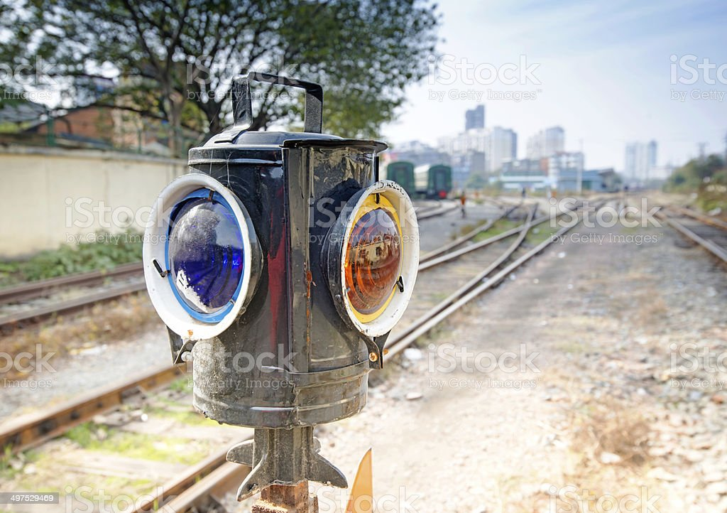 Traffic light shows blue signal on railway royalty-free stock photo