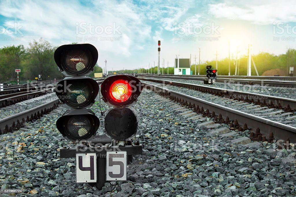 Traffic light shows red signal on railway. Prohibiting signal. stock photo