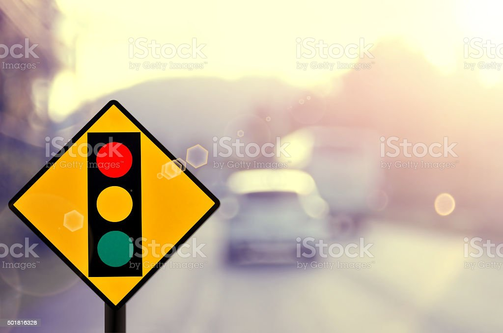Traffic light sign on blur traffic road abstract background. stock photo