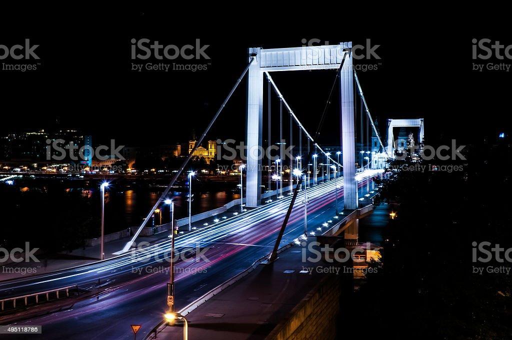 Traffic light trails at a white bridge at night stock photo