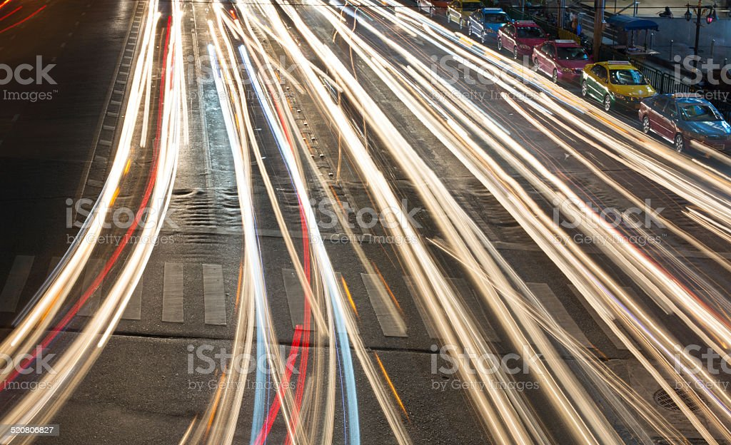 Traffic light trails at busy junction in central Bangkok, Thailand. stock photo