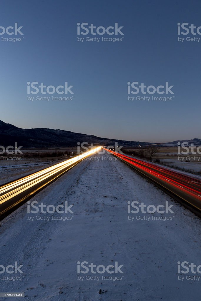 Traffic light trails from a centered perspective stock photo