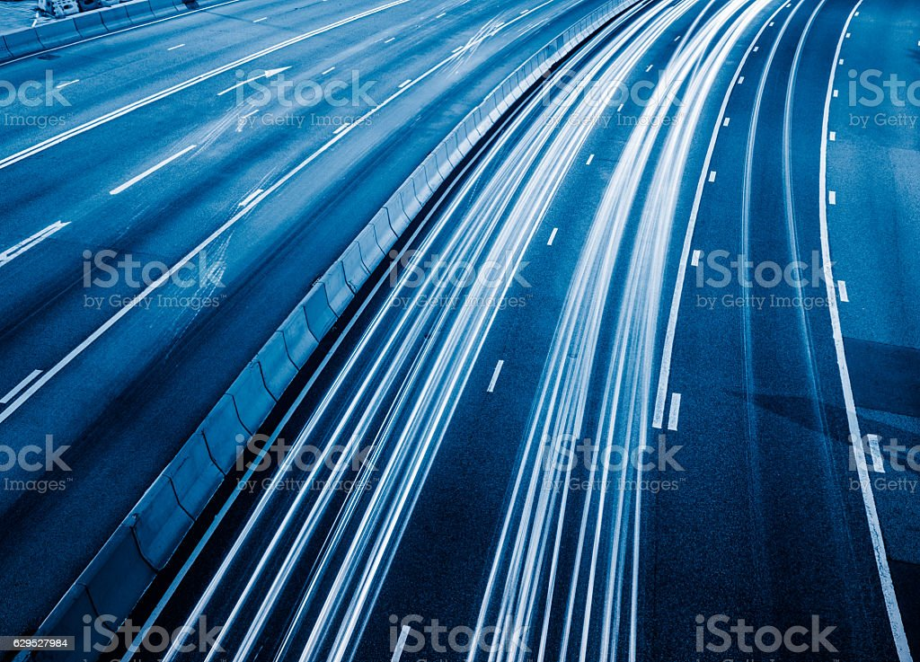 Traffic light trails in downtown of Hong Kong stock photo