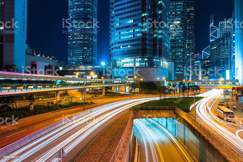 traffic light trails  in modern city at night,hongkong stock photo