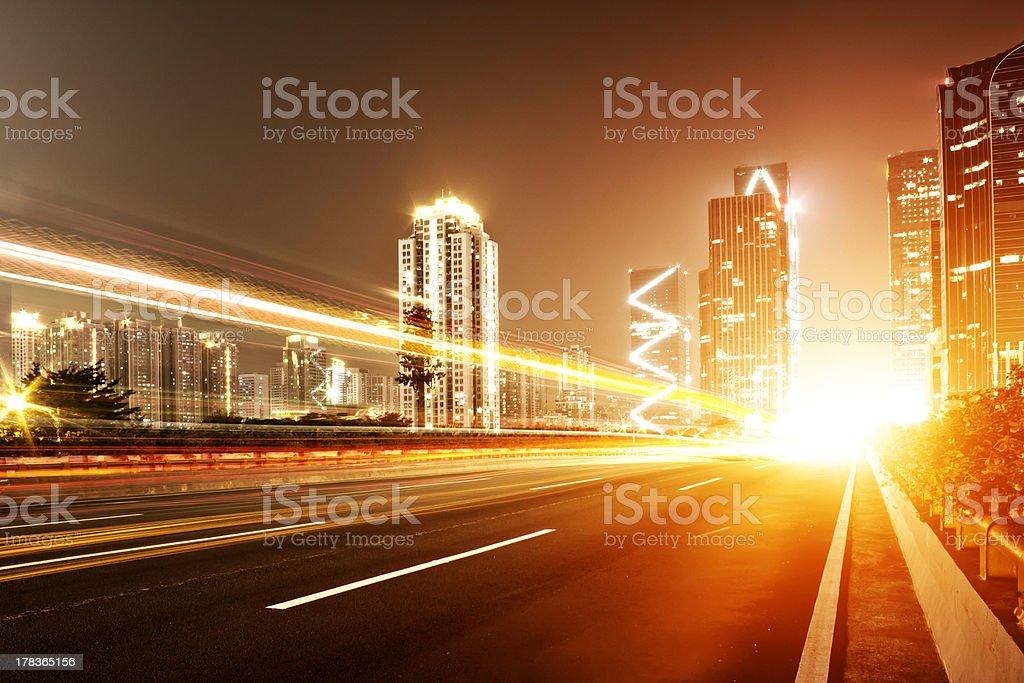 Traffic light trails in urban landscape stock photo