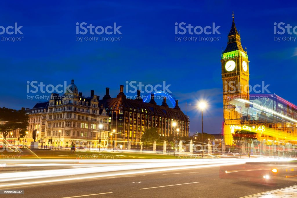 Traffic light trails on Parliament Square near Big Ben in London stock photo