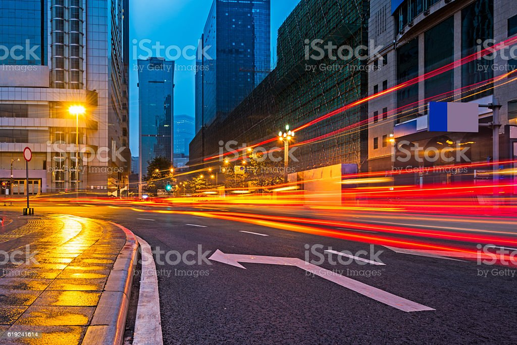 traffic light trails on road at night stock photo
