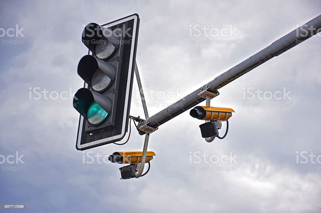 Traffic light with speed cameras stock photo