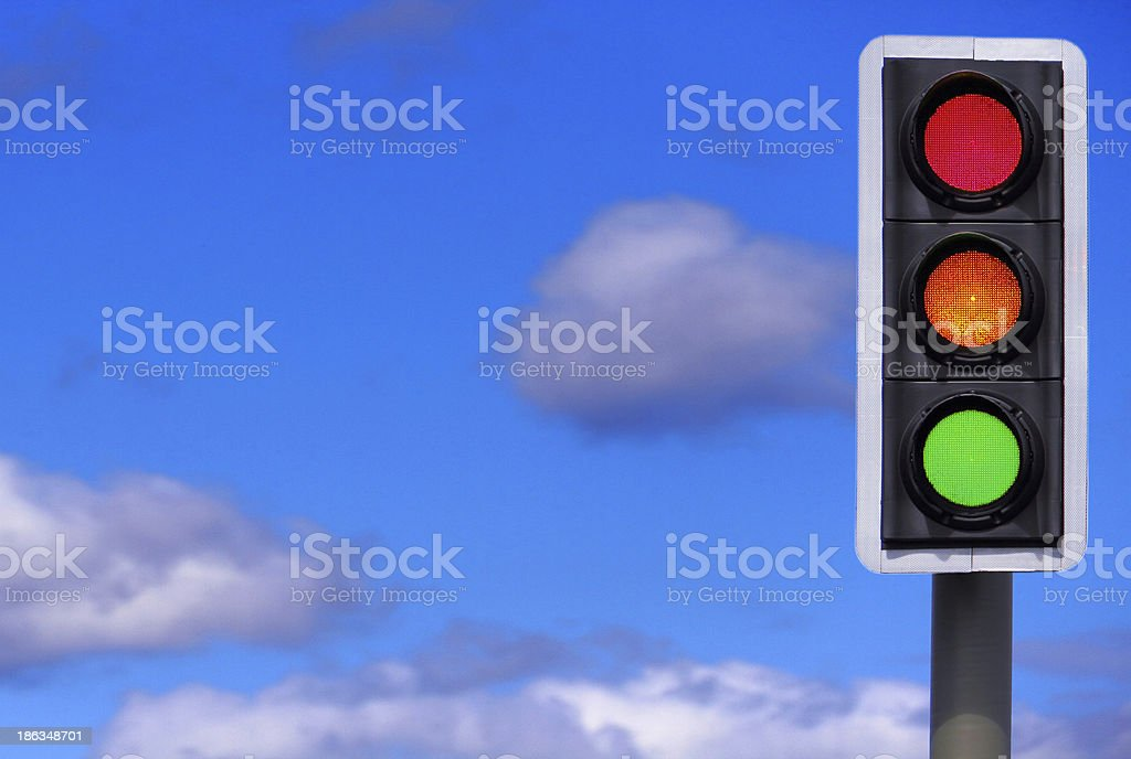 Traffic Lights: All 3 Lights Illuminated. stock photo