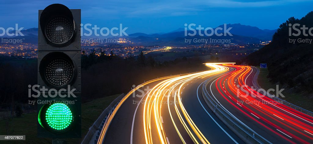traffic lights, car lights at night on the road. stock photo