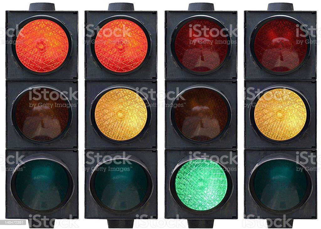 Traffic lights lined up, red yellow and green lit stock photo