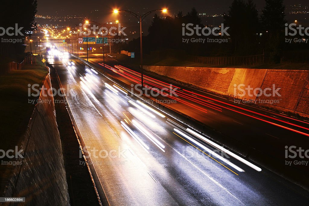 Traffic Lights on Highway at Night royalty-free stock photo