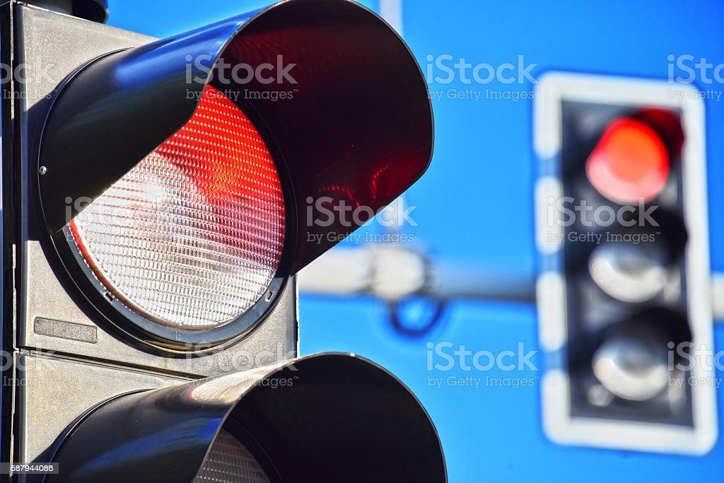 Traffic lights over blue sky stock photo