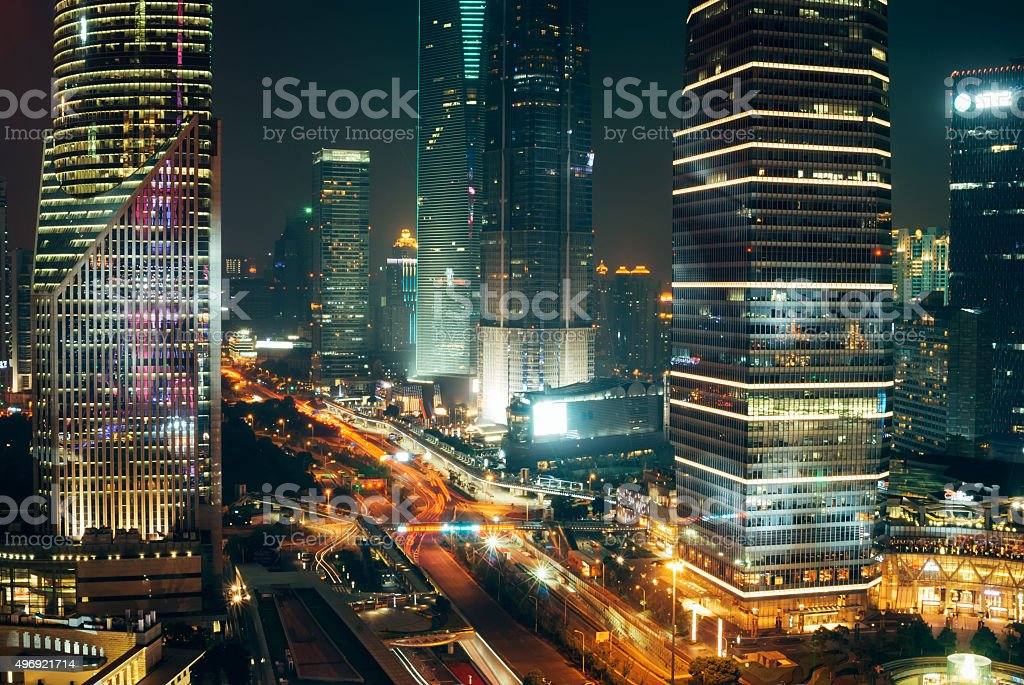 Traffic Lights, Skyscrapers in Shanghai Downtown at Night stock photo