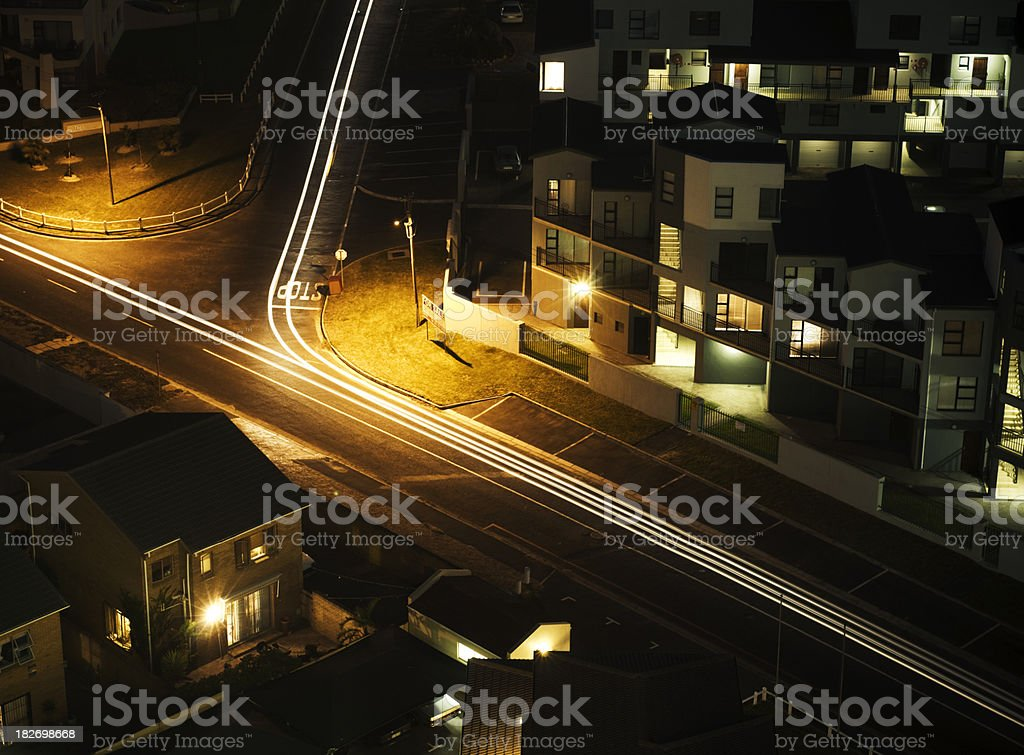 Traffic lines in suburbs at night royalty-free stock photo