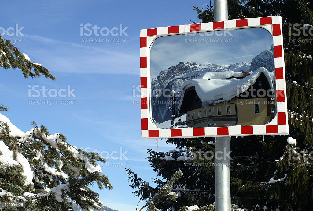 Traffic mirror in snowwhite environment stock photo