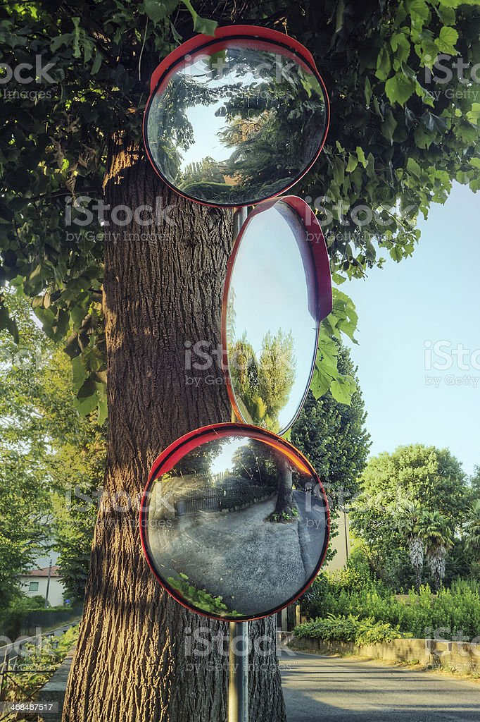 Traffic mirrors, looking in all directions stock photo