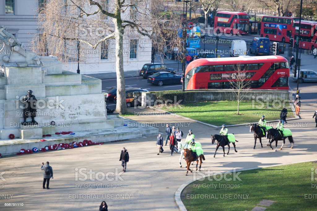 traffic, mounted police and passers-by near Hyde Park London stock photo
