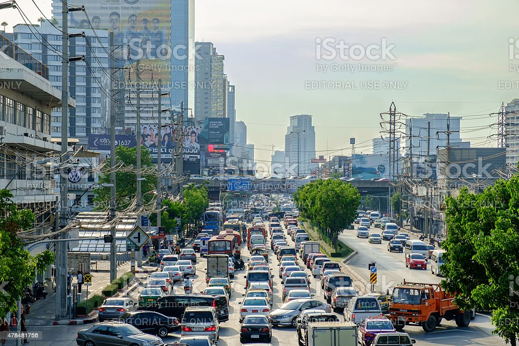 Traffic moves slowly along a busy road stock photo