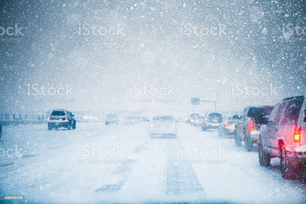 Traffic Moving Slowly Away On In A Winter Storm stock photo