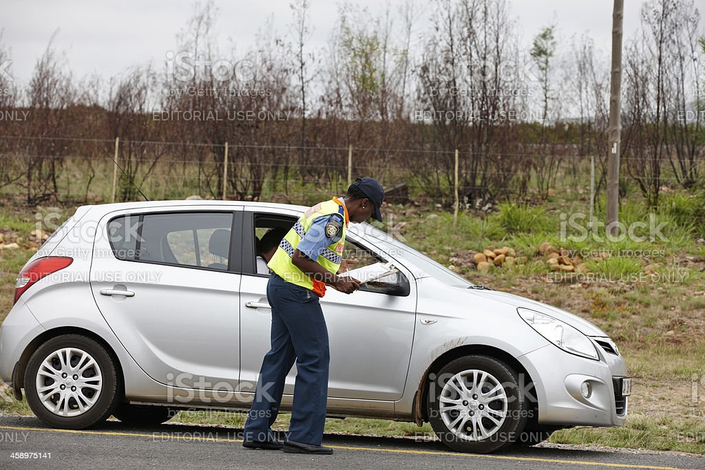 Traffic officer doing vehicle check royalty-free stock photo