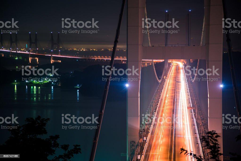 Traffic on a bridge at night stock photo
