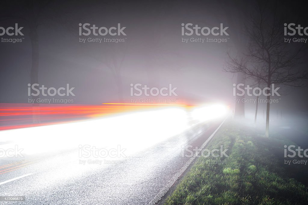 Traffic on a foggy highway stock photo
