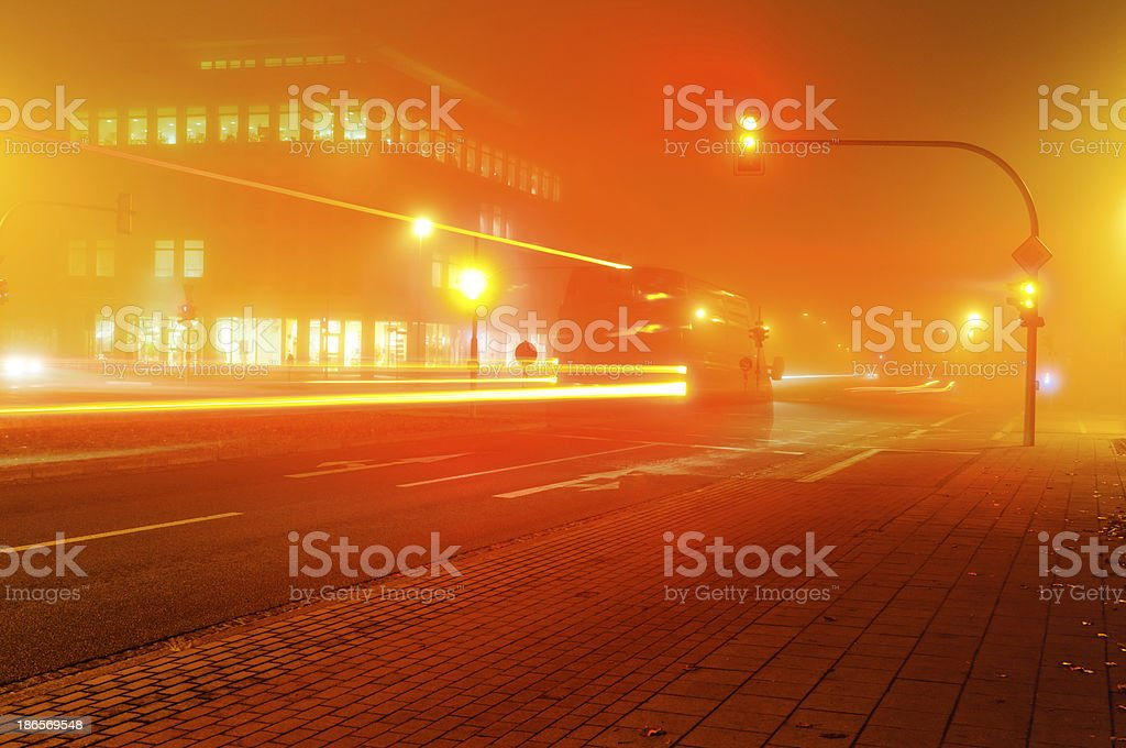 Traffic on a foggy intersection stock photo
