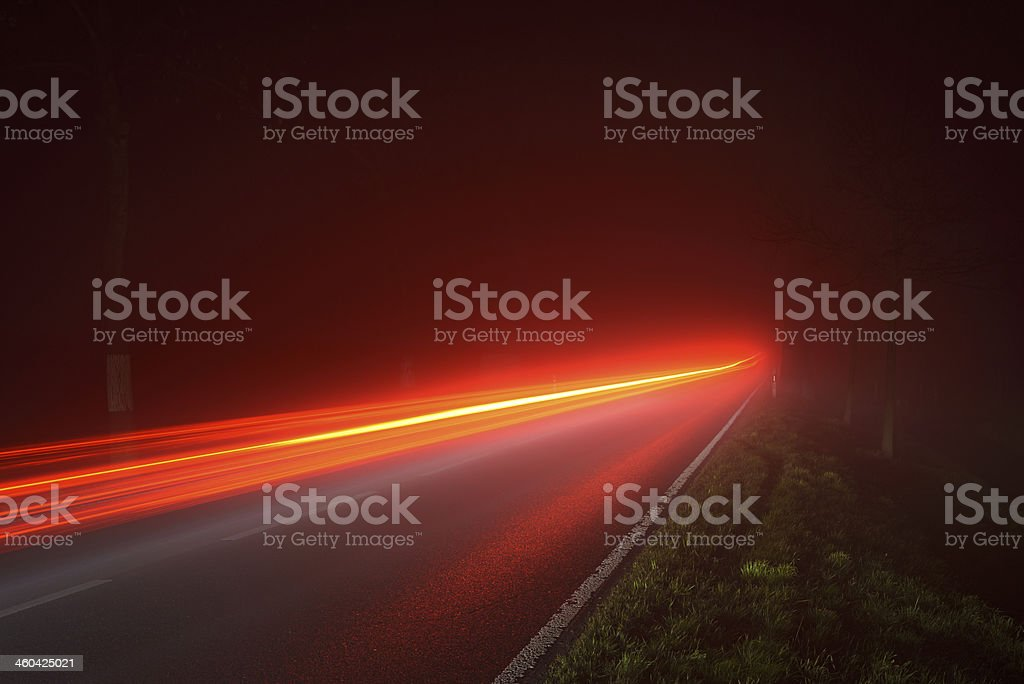 Traffic on a foggy road stock photo