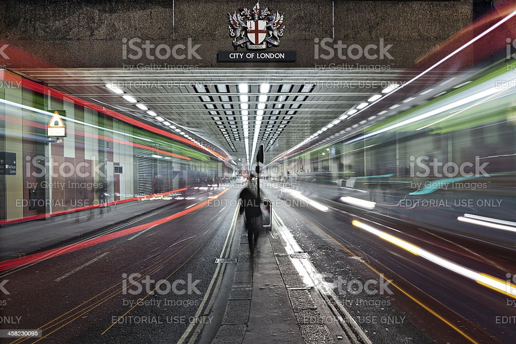 Traffic on a street at night royalty-free stock photo