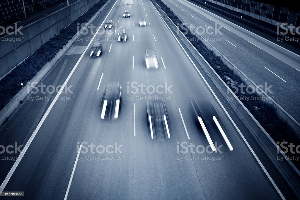 Traffic on Autobahn A3 at dusk, high angle view stock photo