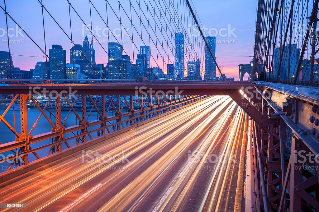 Traffic on Brooklyn Bridge at Dusk, Manhattan Skyline, New York stock photo
