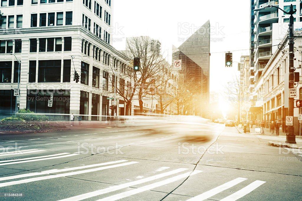 traffic on cityroad through modern buildings in seattle stock photo