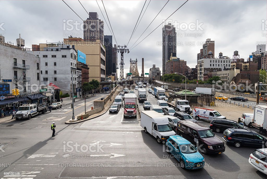 traffic on East 60th Street of Manhattan and Queensboro Bridge stock photo