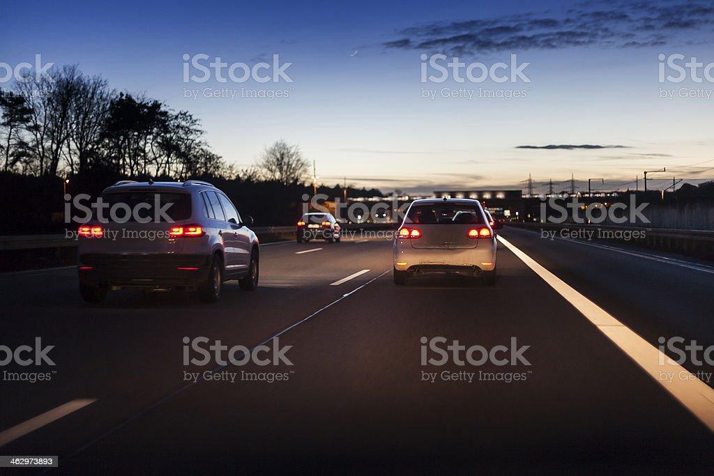 Traffic on german autobahn at dusk stock photo