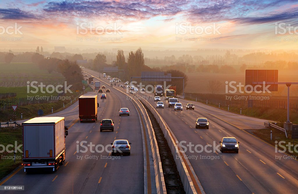 Traffic on highway with cars.