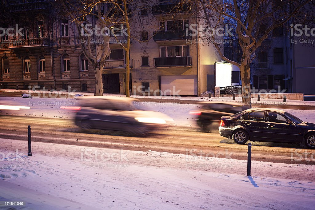 Traffic on icy winter street in the city royalty-free stock photo