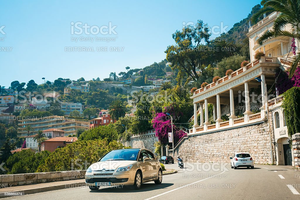 Traffic on in suburbs of village of Villefranche-Sur-Mer in France stock photo