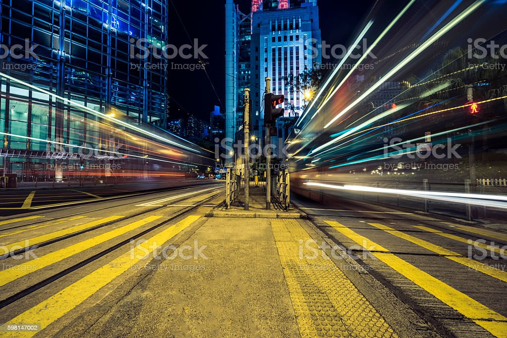 traffic on inner city street, hong kong stock photo